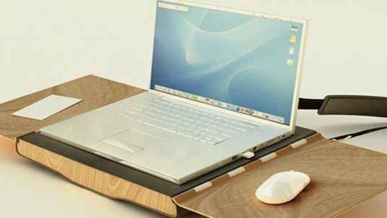 Bu laptop çantası hem sandalye hem masa!