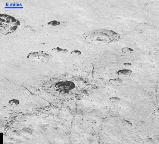 Plüton'un yüzeyinin altında okyanus olabilir - Page 2