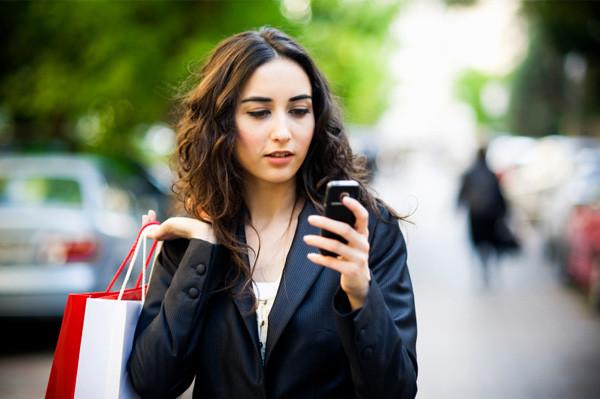 1342443021_woman-running-errands-smartphone.jpg