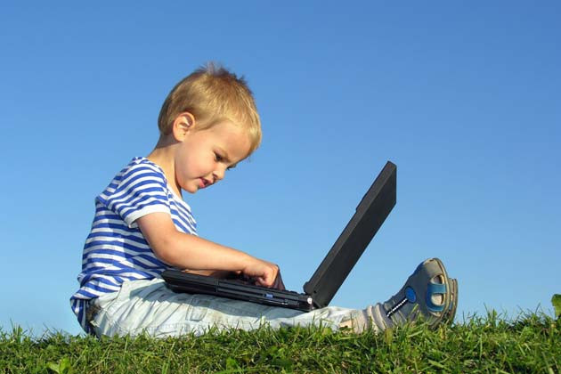 1360753618_child-with-computer.jpg