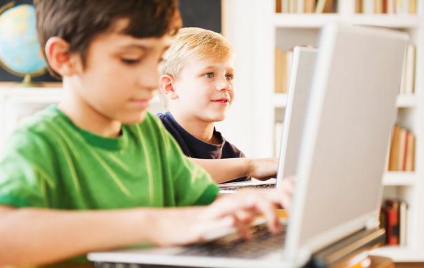 1389183347_boys-using-laptops-in-classroom-840955.jpg
