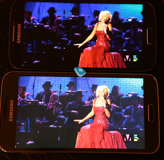 1395259979_galaxy-s5-at-the-bottom-vs-galaxy-s4-during-video-display-2.jpg