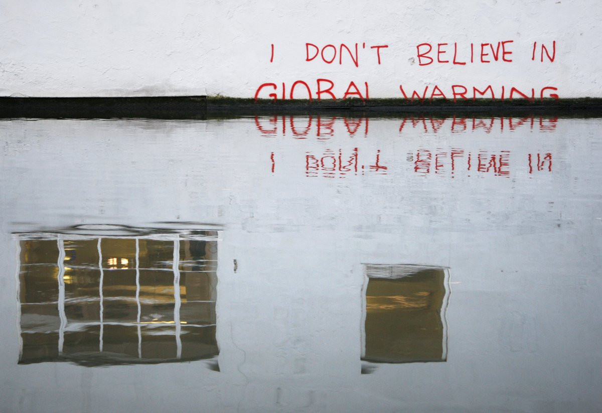 1417178773_but-even-in-the-face-of-overwhelming-evidence-for-human-caused-climate-change-climate-skepticism-still-runs-rampant-this-graffiti-on-a-wall-by-londons-regents-canal-is-beli.jpg