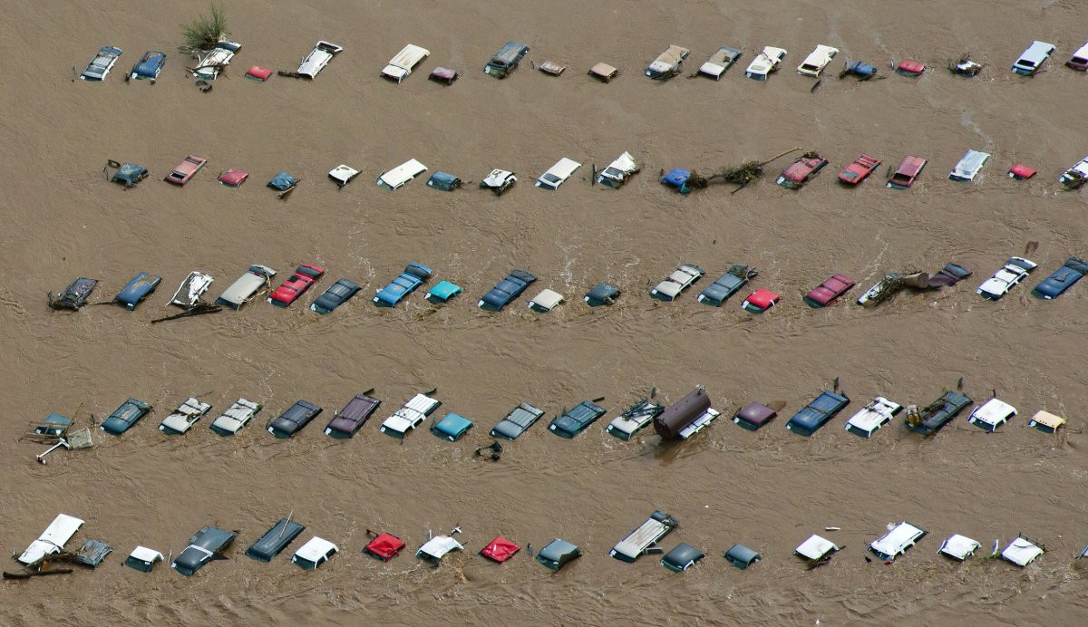 1417178829_flood-rates-are-also-expected-to-increase-as-sea-levels-rise-and-severe-storms-become-more-common-the-2013-south-platte-river-flood-in-colorado-left-these-vehicles-submerge.jpg