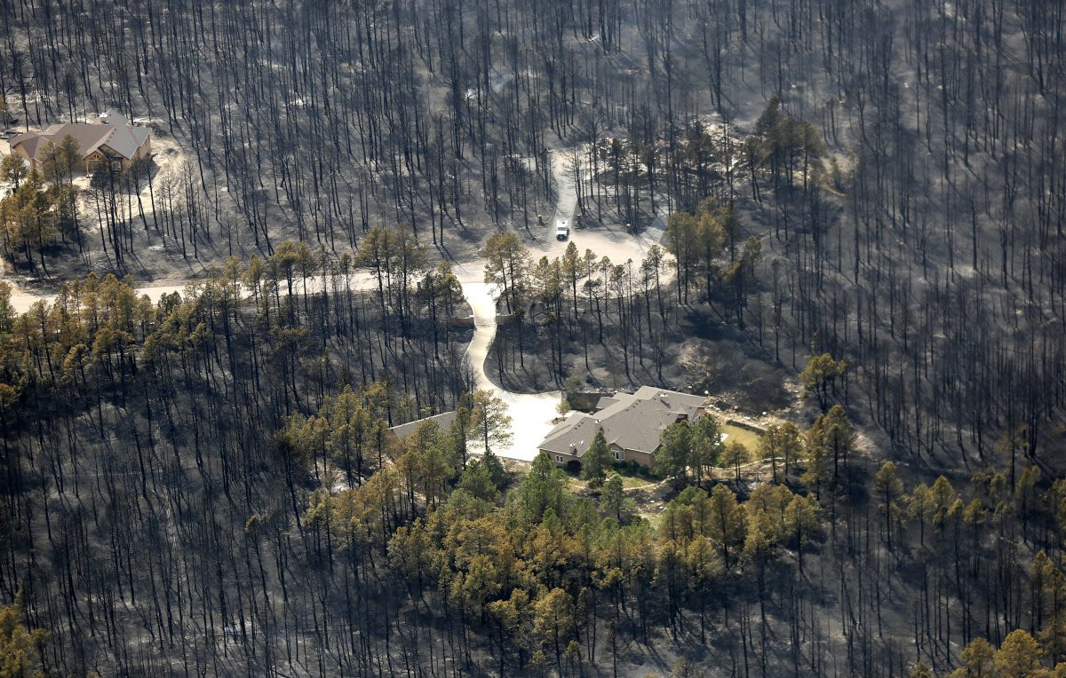 1417178959_the-us-has-seen-its-fair-share-of-wildfires-in-recent-years-and-projections-call-for-worse-outbreaks-in-the-future-here-a-couple-of-isolated-houses-sit-undamaged-in-the-aft.jpg