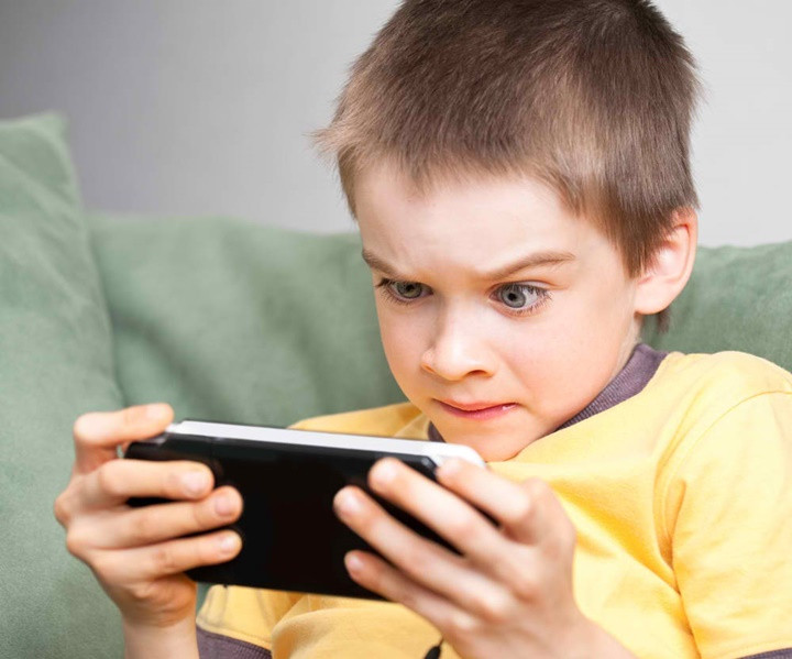 1493205007_young-boy-playing-handheld-game-console.jpg